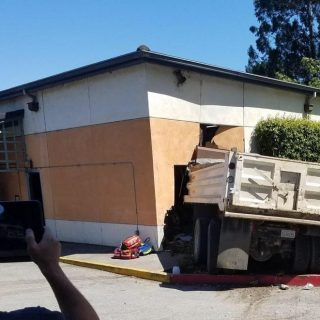 Truck driver arrested after senior center crash