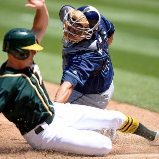 A's bats break out, back Sonny Gray in win