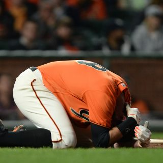 Belt leaves game, Giants fade quietly into 2-1 loss