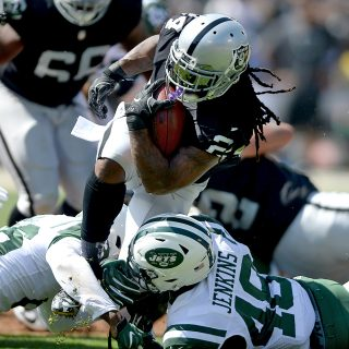 Lynch, Raiders dance to dominating win over Jets