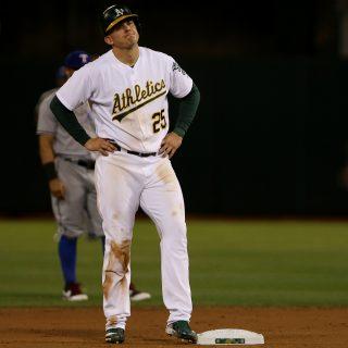A's bolster bullpen, add shortstop prospect in trade for Healy