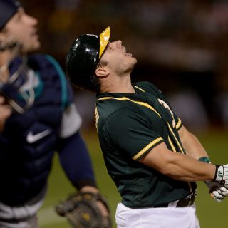 Mengden, A's topped by former mates in late loss