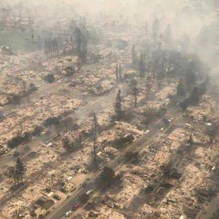 Evacuations widen as wildfires continue to rage