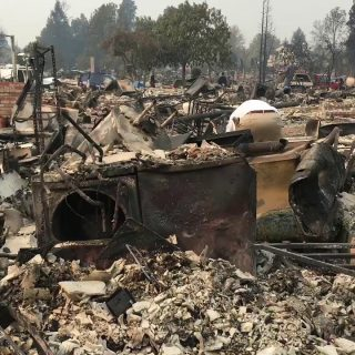High winds forecast as death toll from fires climbs