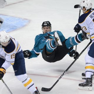 Sharks hang on, top Buffalo for first win