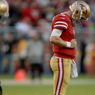 Beathard takes a beating, 49ers drop to 0-9