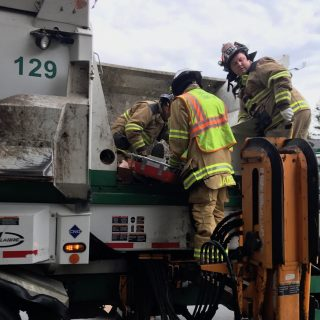 Man rescued from inside garbage truck