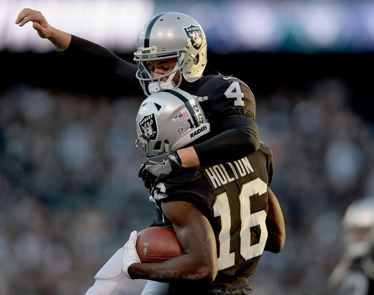 Raiders survive Giants, rise to top of AFC West
