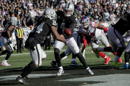 Raiders survive Giants, rise to top of AFC West 54