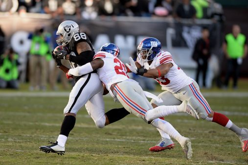 Raiders survive Giants, rise to top of AFC West 24
