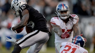 Raiders survive Giants, rise to top of AFC West 6