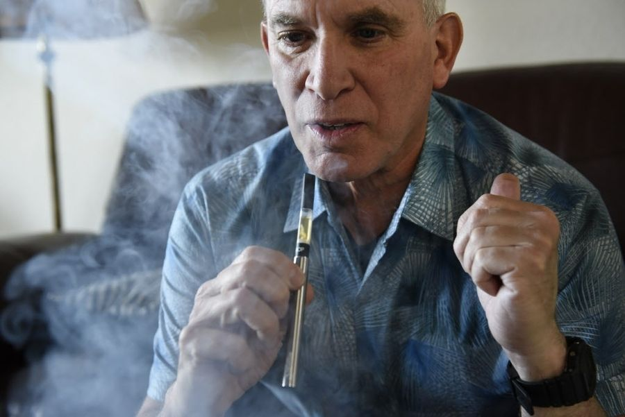 David Goldman takes a puff from a vape pen at his home in San Francisco, CA, on Wednesday March 15, 2017. Goldman directs the Brownie Mary Democratic Club in San Francisco; a cannabis interest group. PHOTO: Michael Short