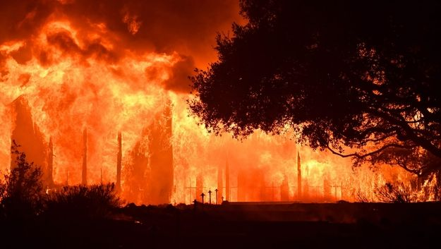 The main building at Paras Vinyards burns in the Mount Veeder area of Napa in California on October 10, 2017. Firefighters battled wildfires in California's wine region on Tuesday as the death toll rose to 15 and thousands were left homeless in neighborhoods reduced to ashes. SOURCE: JOSH EDELSON/AFP/Getty Images