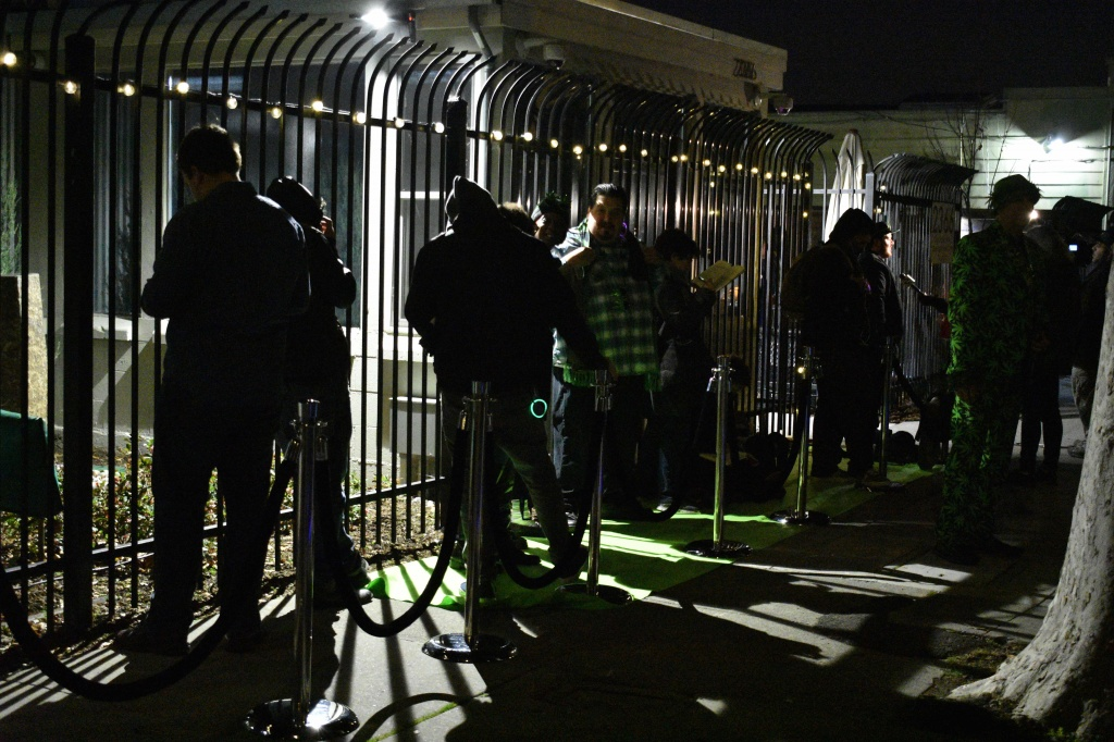 Consumers stand in line early in the morning outside of Berkeley Patients Group on Jan. 1.