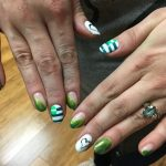 A Harborside staffer shows off her custom nails for launch day.
