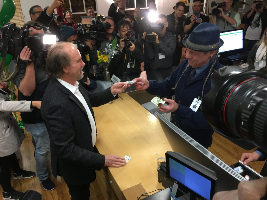 Harborside founder DeAngelo sells the first gram of legal marijuana on Jan. 1 at 6 am to Harborside Attorney Henry Wykowski.