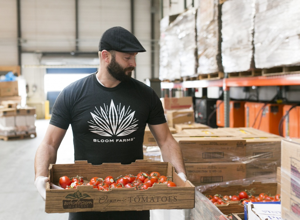 Bloom Farms' CEO Mike Ray helps out at the San Francisco-Marin Food Bank. | Photo courtesy of Bloom Farms
