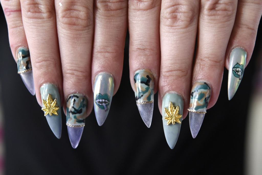 Manicurist Christina Blea shows off her cannabis-themed manicure at her Dabulous Nail Bar, in her home in Richmond, Calif., on Wednesday January 31, 2018.