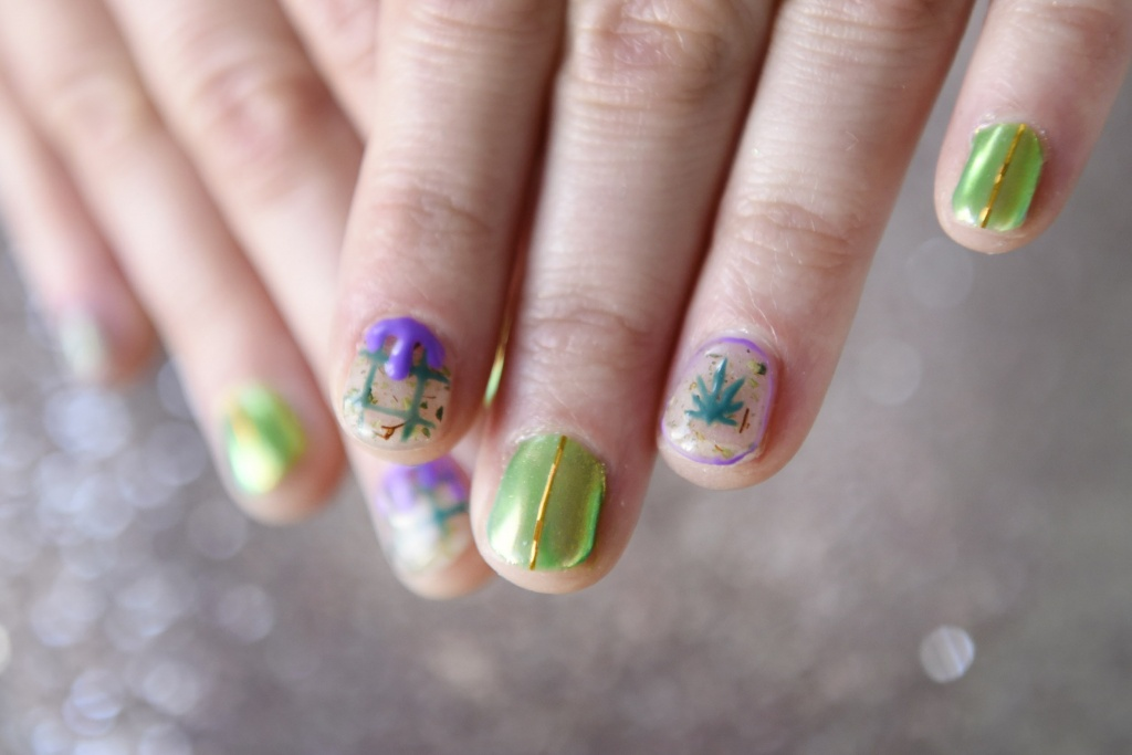 Writer Emily Earlenbaugh shows off her Cannabis themed manicure given to her by Christina Blea at her Dabulous Nail Bar, in her home in Richmond, Calif., on Wednesday January 31, 2018. | Photo: Michael Short
