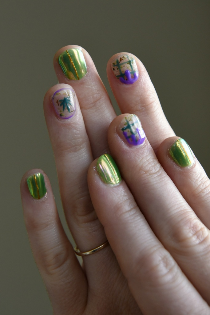 Writer Emily Earlenbaugh shows off her cannabis-themed manicure given to her by Christina Blea at her Dabulous Nail Bar, in her home in Richmond, Calif., on Wednesday January 31, 2018.
