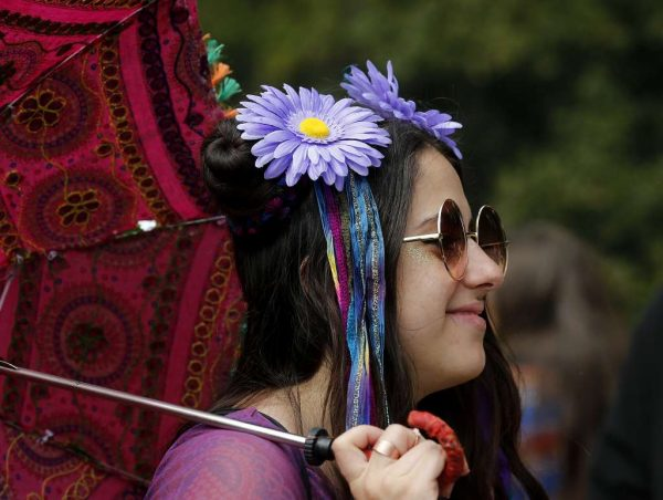 Gia from San Rafael, Calif. got into a 60s dress code to celebrate the day. The annual four twenty celebration of marijuana smoking was attended by thousands near Hippie Hill in Golden Gate Park.