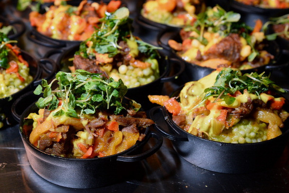 Moroccan lamb tagine is served at the Bacchanal Buffet booth at Vegas Uncork'd by Bon Appetit's Grand Tasting event at Caesars Palace. | Photo: Getty