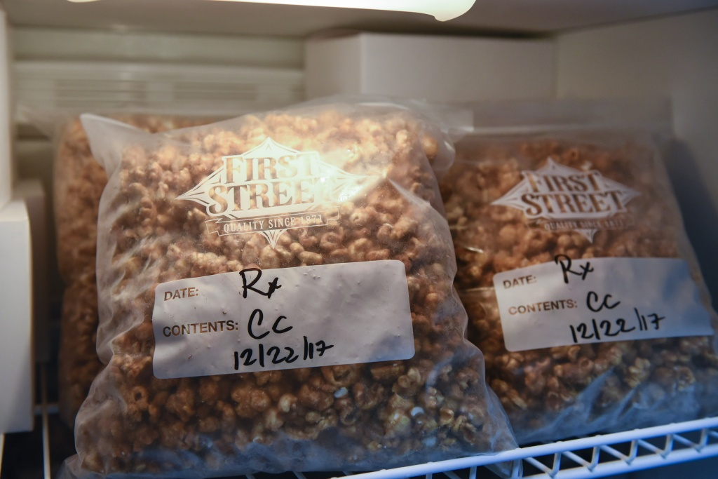 Back stock bags of caramel corn, that are part of Auntie Dolors' discontinued cannabis edible line, sit in a refrigerator at the company's offices in Oakland, Calif. | Photo: Michael Short