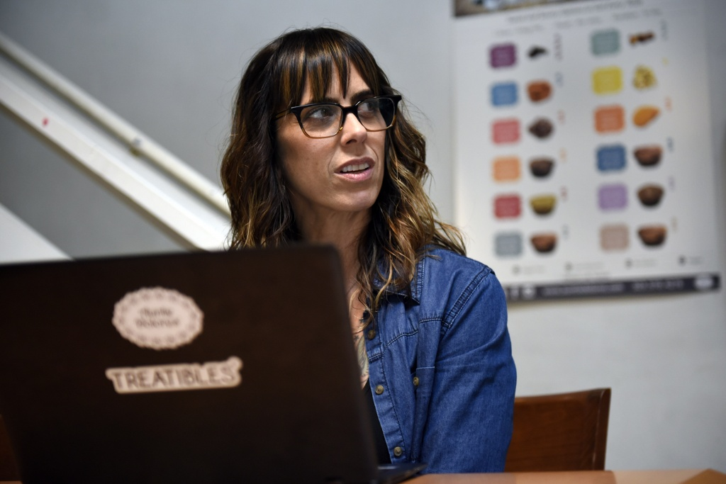 Julianna Carella, CEO and Founder of Auntie Dolores and Treatibles, works on her computer in her company's offices in Oakland, Calif. | Photo by Michael Short