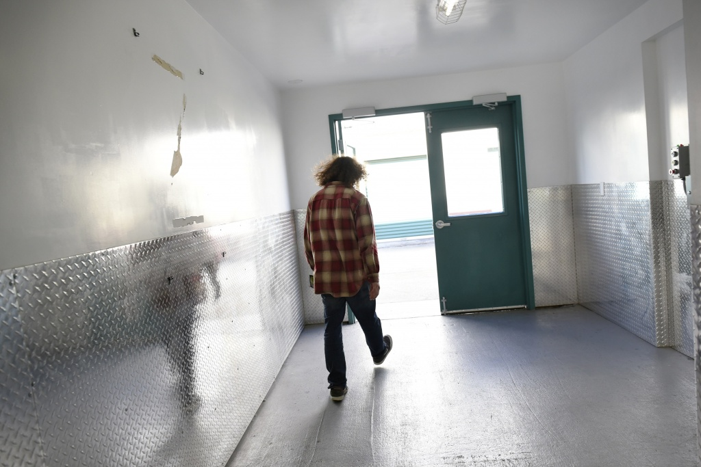 Brian Edwards walks out of a storage space where he stores his idle kitchen equipment used to produce his Higherveda Medicinals edibles line, in San Leandro, Calif. | Photo: Michael Short