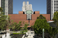 View of SFMOMA Botta building with trees and surrounding buildings