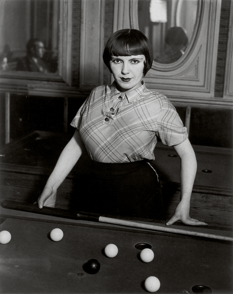 Black and white photograph of a billiard player