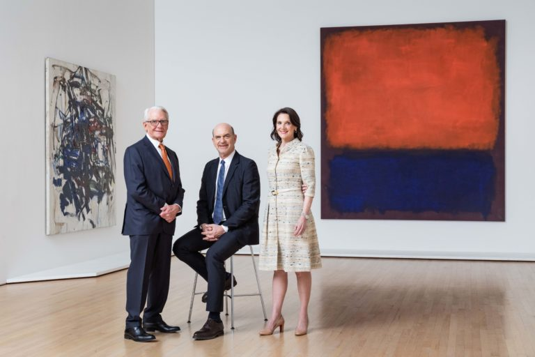 A group portrait of Charles Schwab, Robert Fisher and Diana Nelson in a gallery