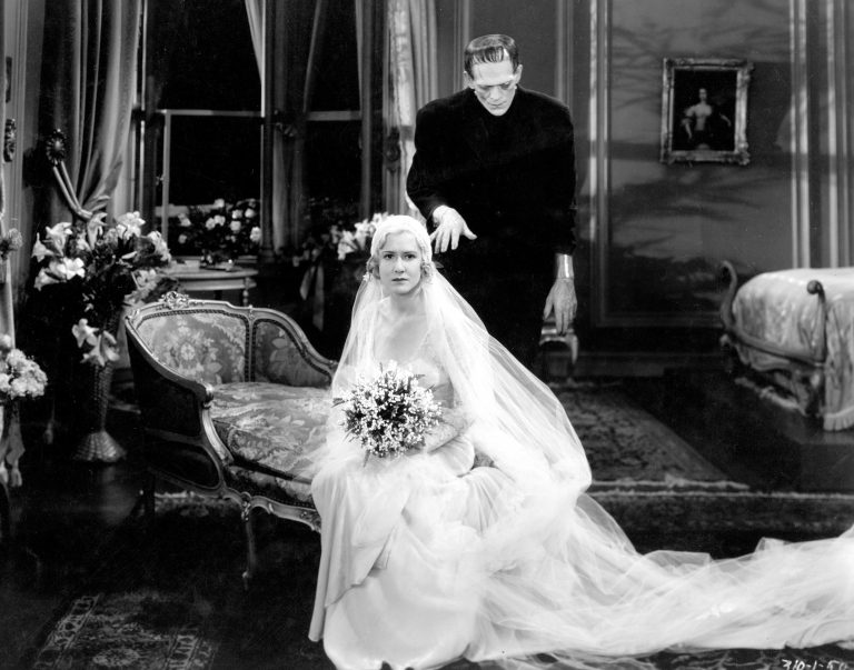 Black and white film still of Frankenstein and a bride