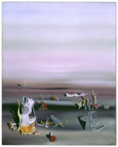 <p>This three foot tall, two-and-a-half foot wide oil painting features unusual forms in a vast open space. The strange forms occupy the bottom third of the canvas, while the upper two thirds is a great expanse of misty violet haze. In this dream-like world, the mysterious forms cast shadows on the cloudy gray ground, which transitions into the pastel sky without a distinct horizon line. The forms themselves are unique and bizarre, painted with crisp detail and an opalescent palette. Some have biomorphic elements that resemble undulating seashells or melted plastic, while others have features that suggest blown glass and corrugated tin. Several of the forms are linked by taut threads or wires, though no pattern is readily discernible.</p>