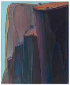 <p>This five-and-a-half foot tall, four-and-a-half foot wide oil painting features a row of massive, towering cliffs rendered in indigo, purple, and orange. The dark and precipitous cliffs occupy the entire painting save for thin slivers of pale blue sky on our left and at the upper edges of the canvas. In the foreground on our right is a massive, sheer, indigo and purple cliff, topped with a tilted orange field dotted with tiny trees. Its shape resembles that of a smooth-sided pint glass, filled to the brim: straight, slightly tapered sides, with a flat top and a round rim. Just beyond it, a series of lower tiered cliffs, one behind the other, descends to our left. The cliff faces are mostly smooth, but feature a network of raised veins up and down their faces. They are topped with heavy clots of blue, mauve, and orange paint. In the distance, filling the upper left corner of the canvas is another massive escarpment, rendered in faded colors from the same palette. The orange field on top curves over the edge and falls in two thin lines down the front of the smooth rock face like water over a waterfall.</p>
