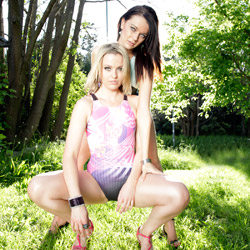 Two lovely ladies in black, baby pink and purple high leg, racerback swimsuits