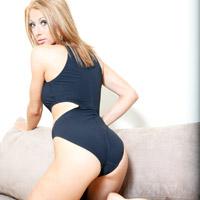 Mel in a black zipper back, high neck, high leg swimsuit