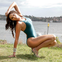 Marissa in a green high leg, racerback Asics swimsuit