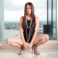 Katya in a black high leg, racerback Asics swimsuit
