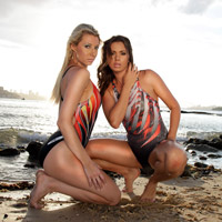 Two lovely ladies in yellow, red, orange, grey and black racerback Tornado swimsuits