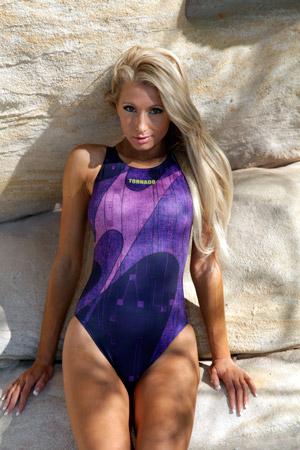 Mel in a purple and black high leg, racerback Tornado swimsuit