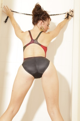 Katya in a red, maroon and black racerback Tornado swimsuit