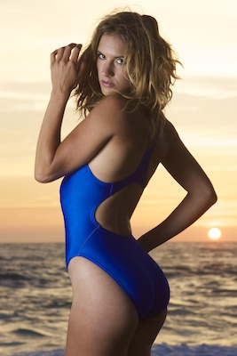 Franny in an electric blue racerback, high leg Tyr swimsuit