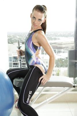 Katya in a white, purple, green and black racerback Tornado swimsuit