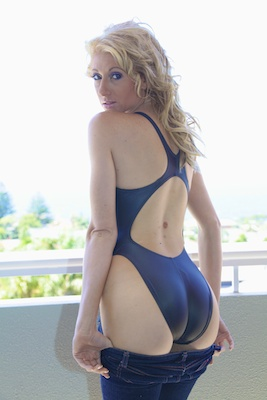 Mel in a blue high leg, racerback Asics swimsuit