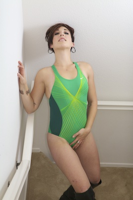 Adayla in a green and yellow pulse back Nike swimsuit