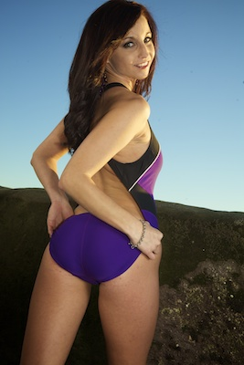 Krystle in a black and purple racerback Nike swimsuit