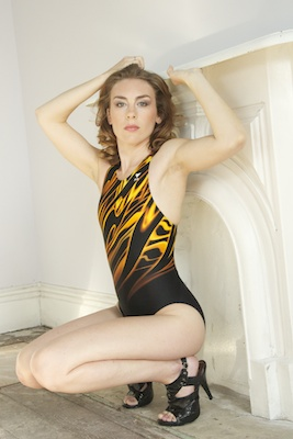 Stephanie in a yellow, orange and black racerback Tyr swimsuit