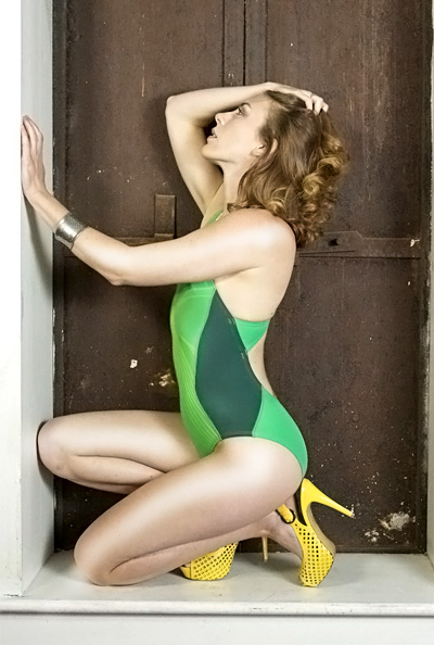 Stephanie in a green and yellow pulse back Nike swimsuit