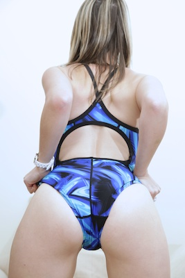 Alexis in a black and electric blue extreme back swimsuit